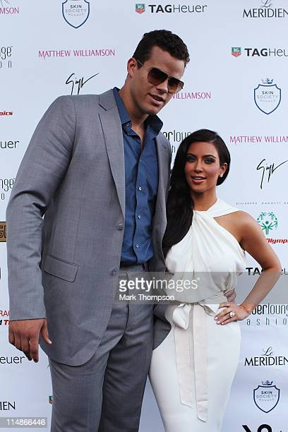 Kim Kardashian and Kris Humphries attend the Amber Fashion Show held at the Meridien Beach Plaza on May 27 2011 in Monte Carlo Monaco