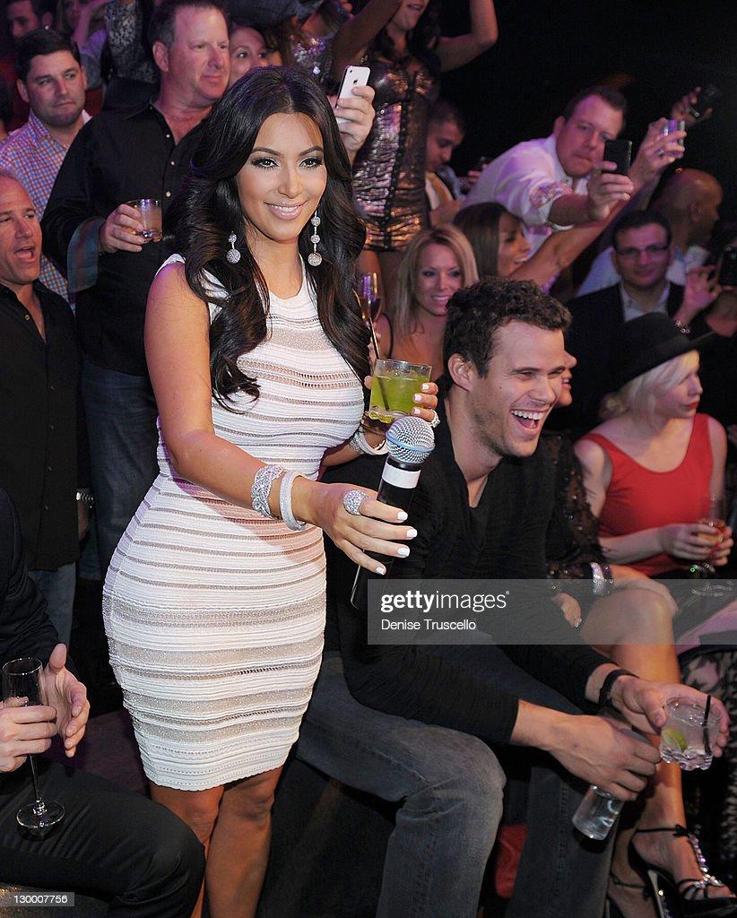 Kim Kardashian and Kris Humphries celebrate Kim Kardashian's birthday at Marquee Nightclun at the Cosmopolitan on October 22, 2011 in Las Vegas, Nevada.