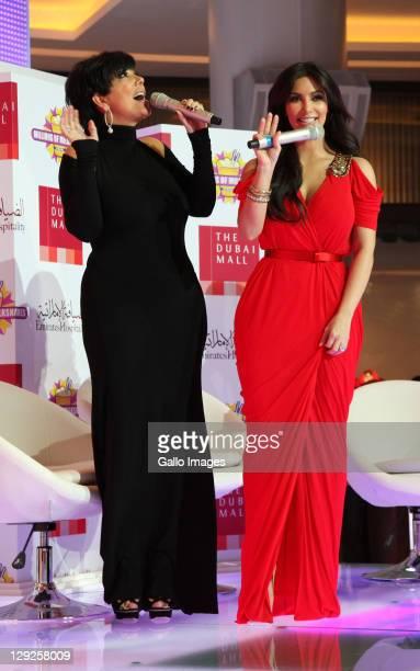 Kim Kardashian and Kris Jenner attend the opening of the new Millions of Milkshakes store at Dubai Mall on October 14 2011 in Dubai United Arab...