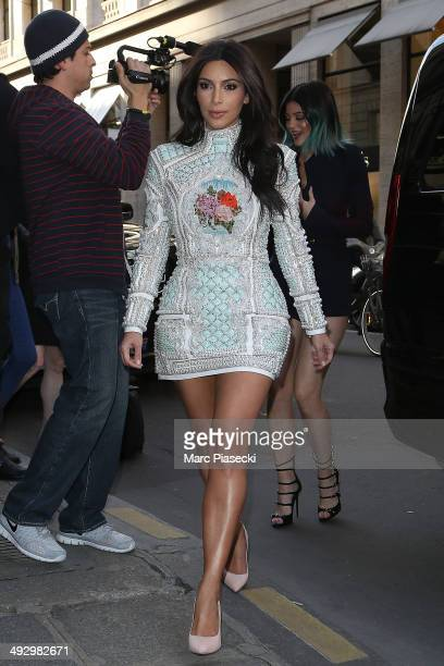 Kim Kardashian and Kylie Jenner arrive at the 'Costes' restaurant on May 22 2014 in Paris France
