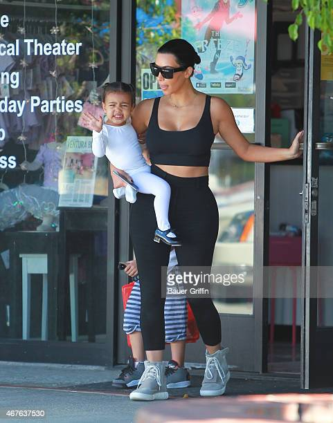 Kim Kardashian and North West are seen in Los Angeles on March 26 2015 in Los Angeles California