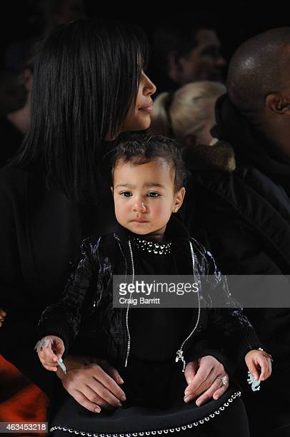 Kim Kardashian and North West attend the Alexander Wang Fashion Show during MercedesBenz Fashion Week Fall 2015 at Pier 94 on February 14 2015 in New...