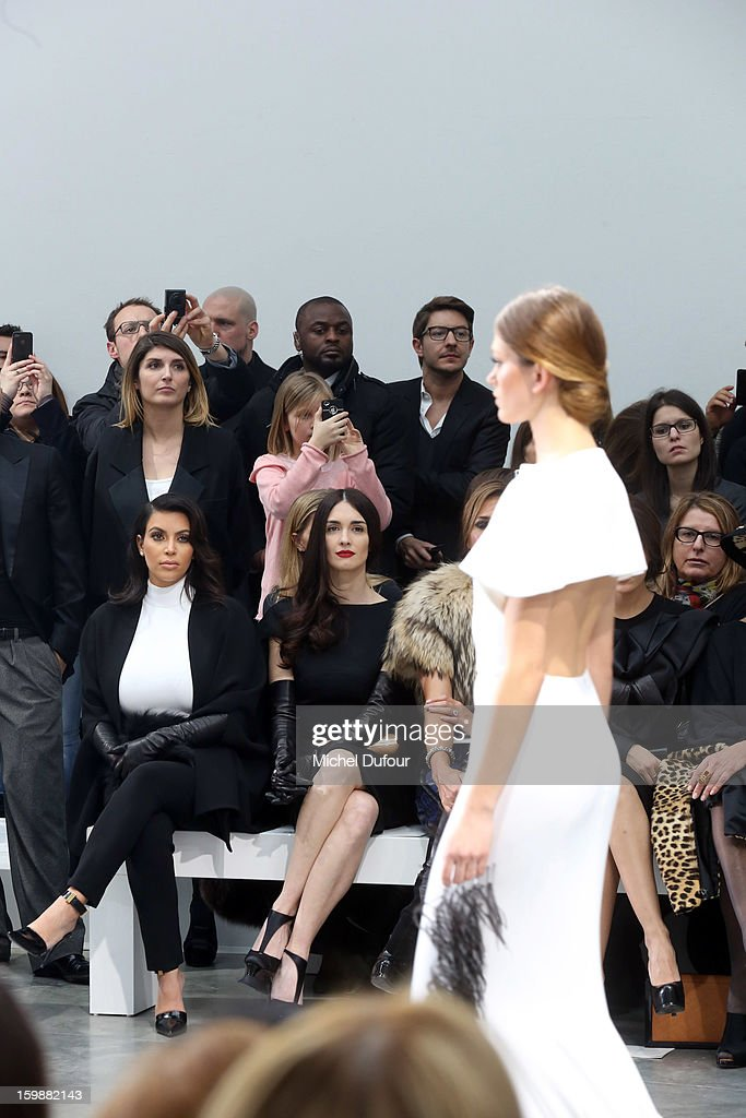 Kim Kardashian and Paz Vega attend the Stephane Rolland Spring/Summer 2013 Haute-Couture show as part of Paris Fashion Week at Palais De Tokyo on January 22, 2013 in Paris, France.