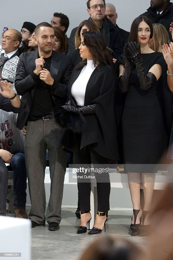 Kim Kardashian (C) and Paz Vega (R) attend the Stephane Rolland Spring/Summer 2013 Haute-Couture show as part of Paris Fashion Week at Palais De Tokyo on January 22, 2013 in Paris, France.