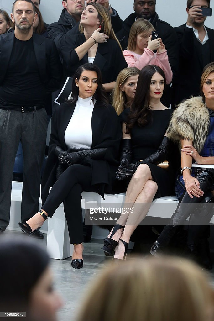 Kim Kardashian and Paz Vega sit in front row at the Stephane Rolland Spring/Summer 2013 Haute-Couture show as part of Paris Fashion Week at Palais De Tokyo on January 22, 2013 in Paris, France.