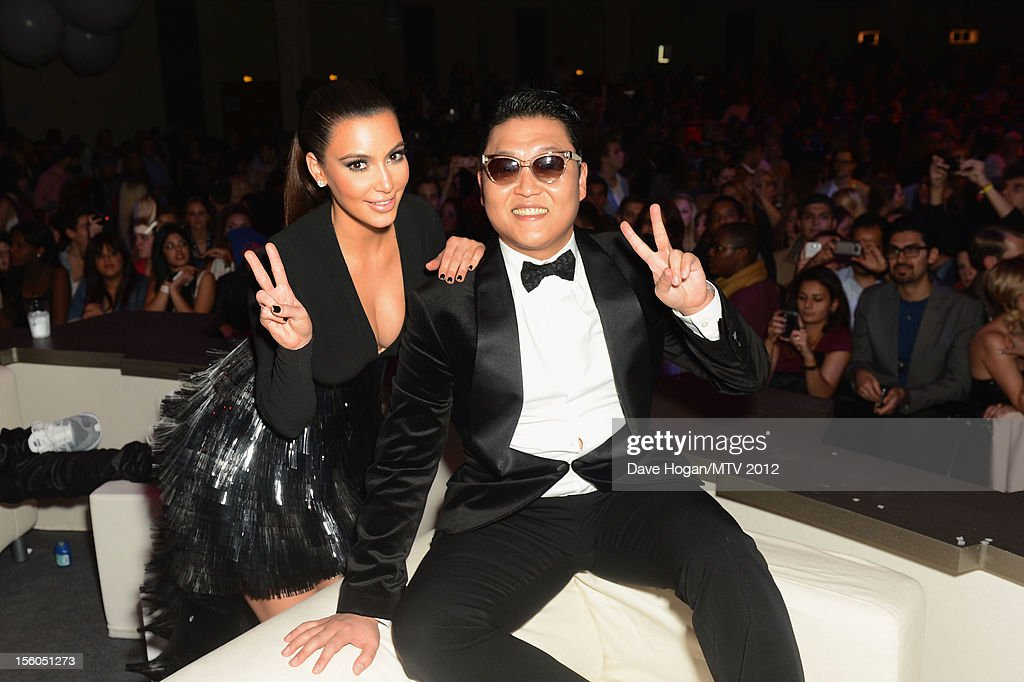 <a gi-track='captionPersonalityLinkClicked' href=/galleries/search?phrase=Kim+Kardashian&family=editorial&specificpeople=753387 ng-click='$event.stopPropagation()'>Kim Kardashian</a> and Psy pose in the VIP Glamour area at the MTV EMA's 2012 at Festhalle Frankfurt on November 11, 2012 in Frankfurt am Main, Germany.