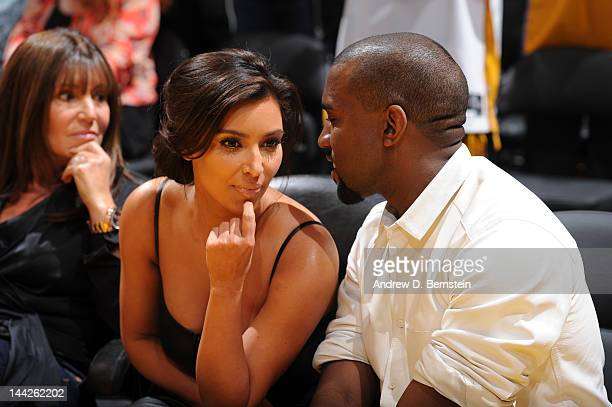 Kim Kardashian and recording artist Kanye West attend a game between the Denver Nuggets and the Los Angeles Lakers in Game Seven of the Western...
