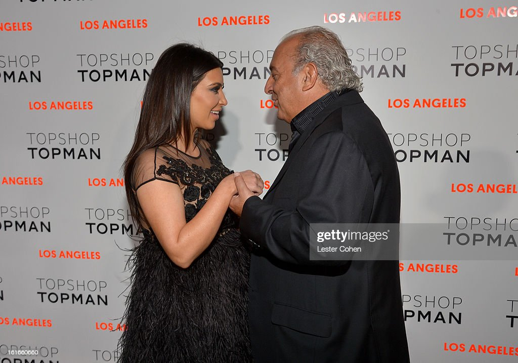 Kim Kardashian (L) and Sir Philip Green arrive at the Topshop Topman LA Opening Party at Cecconi's West Hollywood on February 13, 2013 in Los Angeles, California.