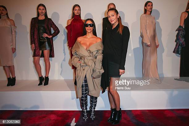 Kim Kardashian and Siran Manoukian attend the Siran Presentation At Hotel Plaza Athenee as part of the Paris Fashion Week Womenswear on October 2...