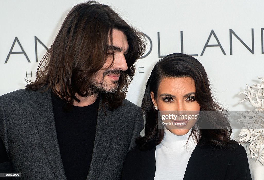 <a gi-track='captionPersonalityLinkClicked' href=/galleries/search?phrase=Kim+Kardashian&family=editorial&specificpeople=753387 ng-click='$event.stopPropagation()'>Kim Kardashian</a> and Stephane Rolland pose backstage at the Stephane Rolland Spring/Summer 2013 Haute-Couture show as part of Paris Fashion Week at Palais De Tokyo on January 22, 2013 in Paris France.