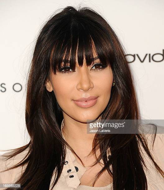 Kim Kardashian and Tracy Anderson attend the opening of Tracy Anderson Flagship Studio on April 4 2013 in Brentwood California