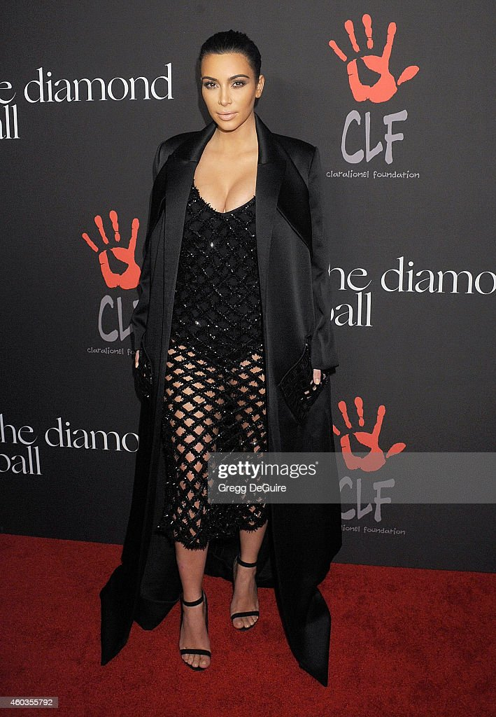 Kim Kardashian arrives at Rihanna's First Annual Diamond Ball at The Vineyard on December 11 2014 in Beverly Hills California