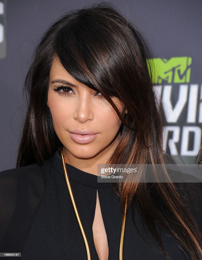 KIm Kardashian arrives at the 2013 MTV Movie Awards at Sony Pictures Studios on April 14, 2013 in Culver City, California.