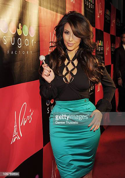 Kim Kardashian arrives at the grand opening of Sugar Factory American Brasserie at Paris Las Vegas on March 4 2011 in Las Vegas Nevada