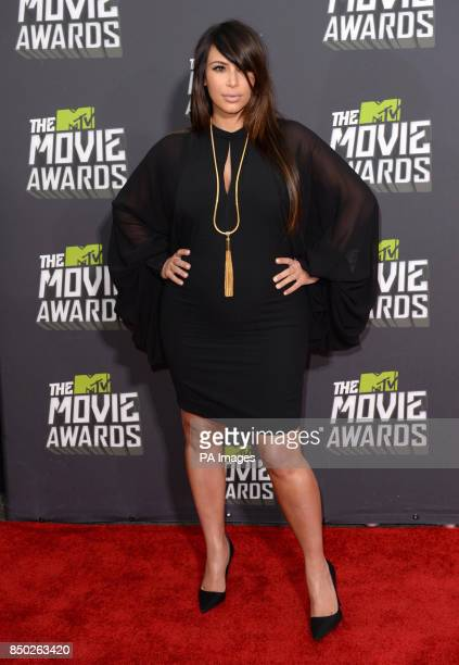 Kim Kardashian arrives at The MTV Movie Awards 2013 at Sony Pictures Studios Culver City Los Angeles