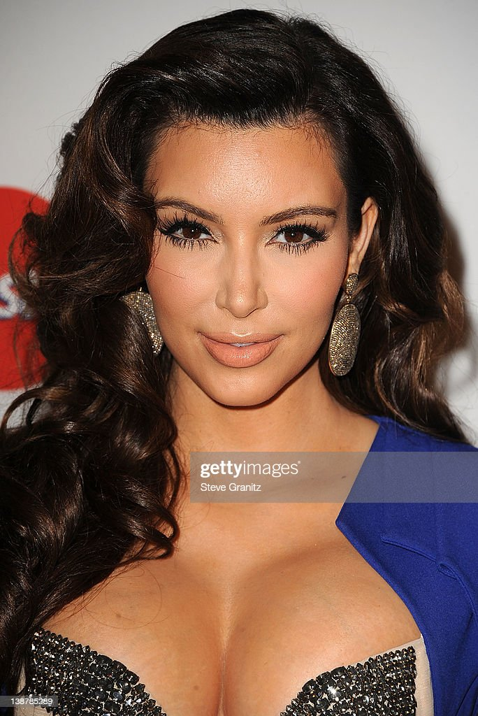 <a gi-track='captionPersonalityLinkClicked' href=/galleries/search?phrase=Kim+Kardashian&family=editorial&specificpeople=753387 ng-click='$event.stopPropagation()'>Kim Kardashian</a> arrives at The Recording Academy's 2012 Pre-GRAMMY Gala And Salute To Industry Icons Honoring Richard Branson at The Beverly Hilton hotel on February 11, 2012 in Beverly Hills, California.