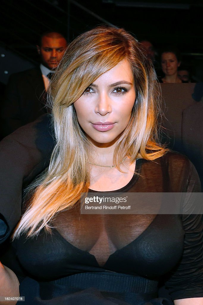 <a gi-track='captionPersonalityLinkClicked' href=/galleries/search?phrase=Kim+Kardashian&family=editorial&specificpeople=753387 ng-click='$event.stopPropagation()'>Kim Kardashian</a> attends Givenchy show as part of the Paris Fashion Week Womenswear Spring/Summer 2014, held at 'la Halle Freyssinet' on September 29, 2013 in Paris, France.