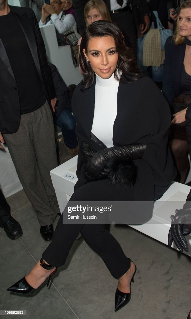 <a gi-track='captionPersonalityLinkClicked' href=/galleries/search?phrase=Kim+Kardashian&family=editorial&specificpeople=753387 ng-click='$event.stopPropagation()'>Kim Kardashian</a> attends the Stephane Rolland Spring/Summer 2013 Haute-Couture show as part of Paris Fashion Week at Palais De Tokyo on January 22, 2013 in Paris France.