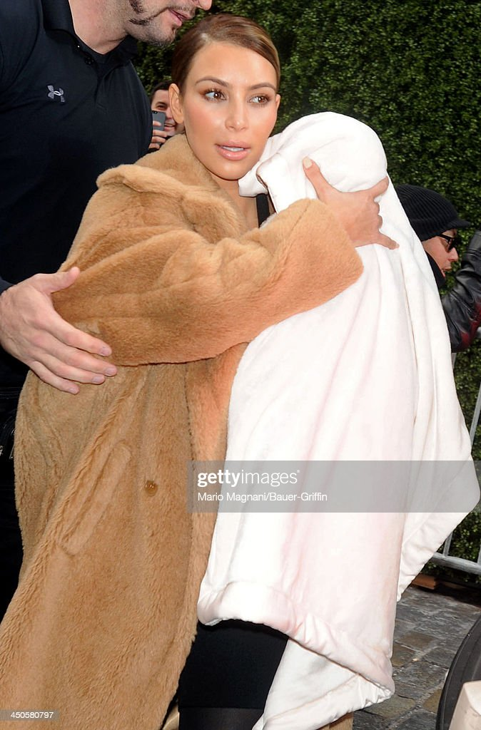 <a gi-track='captionPersonalityLinkClicked' href=/galleries/search?phrase=Kim+Kardashian&family=editorial&specificpeople=753387 ng-click='$event.stopPropagation()'>Kim Kardashian</a> carries her baby North West on November 19, 2013 in New York City.