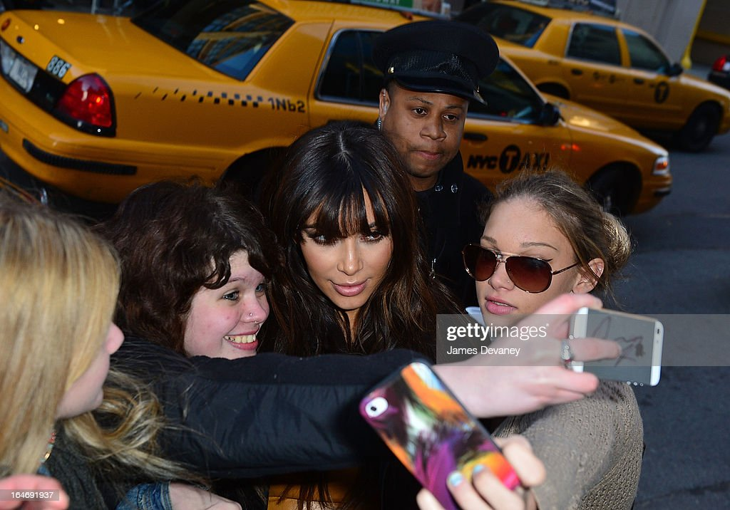 Kim Kardashian greets her fans on the streets of Manhattan on March 26, 2013 in New York City.