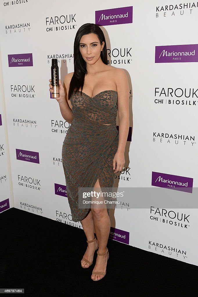 Kim Kardashian introduces 'Kardashian Beauty Hair' line at Marionnaud Champs Elysees on April 15, 2015 in Paris, France.
