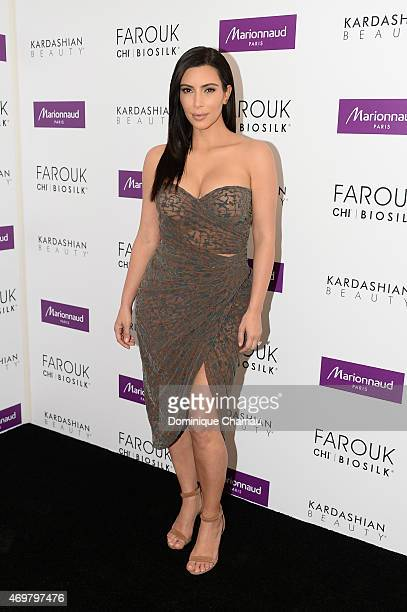 Kim Kardashian introduces 'Kardashian Beauty Hair' line at Marionnaud Champs Elysees on April 15 2015 in Paris France
