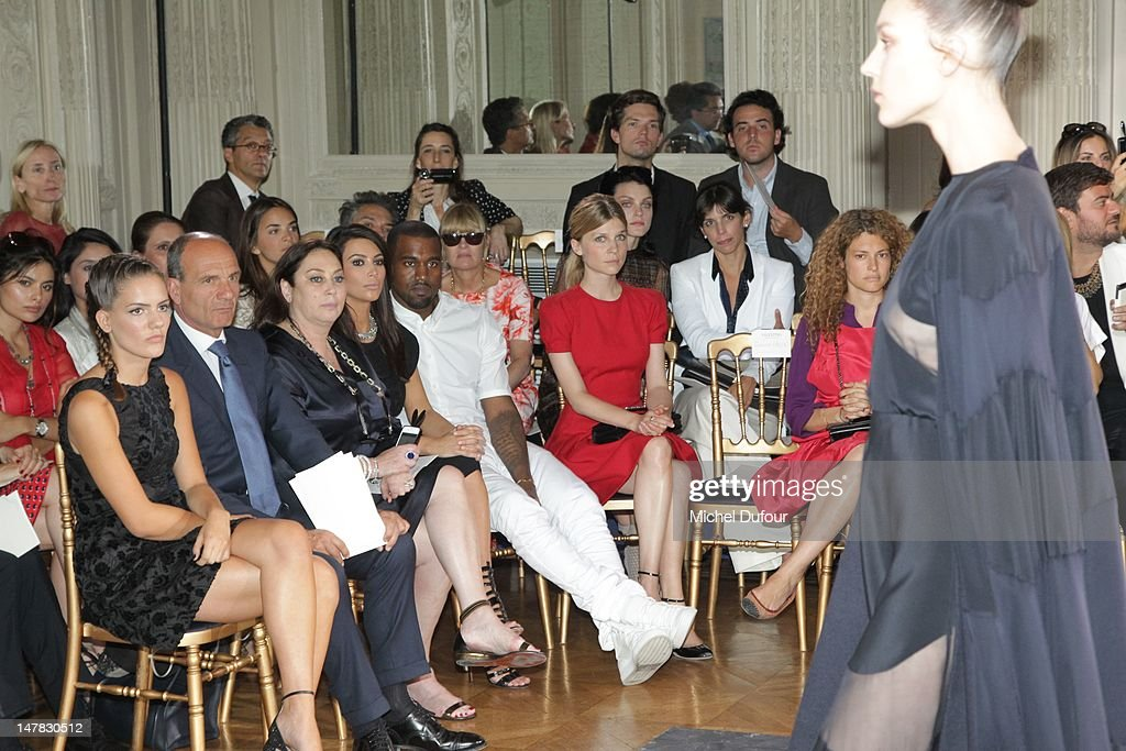 Kim Kardashian, Kanye West and Clemence Poesy attend the Valentino Haute-Couture Show as part of Paris Fashion Week Fall / Winter 2013 at Hotel Salomon de Rothschild on July 4, 2012 in Paris, France.