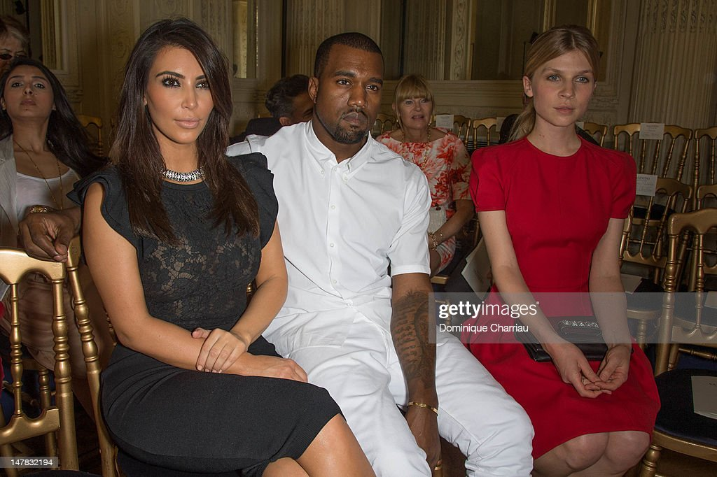 <a gi-track='captionPersonalityLinkClicked' href=/galleries/search?phrase=Kim+Kardashian&family=editorial&specificpeople=753387 ng-click='$event.stopPropagation()'>Kim Kardashian</a>, <a gi-track='captionPersonalityLinkClicked' href=/galleries/search?phrase=Kanye+West+-+Musician&family=editorial&specificpeople=201803 ng-click='$event.stopPropagation()'>Kanye West</a> and <a gi-track='captionPersonalityLinkClicked' href=/galleries/search?phrase=Clemence+Poesy&family=editorial&specificpeople=765034 ng-click='$event.stopPropagation()'>Clemence Poesy</a> attend the Valentino Haute-Couture Show as part of Paris Fashion Week Fall / Winter 2012/2013 at Hotel Salomon de Rothschild on July 4, 2012 in Paris, France.
