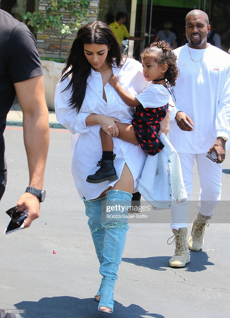 Kim Kardashian, Kanye West and daughter North West are seen on June 25, 2016 in Los Angeles, California.