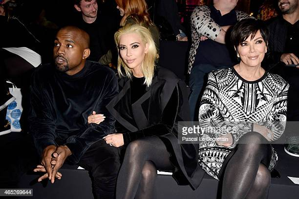 Kim Kardashian Kanye West and Kris Jenner attend the Balmain show as part of the Paris Fashion Week Womenswear Fall/Winter 2015/2016 on March 5 2015...