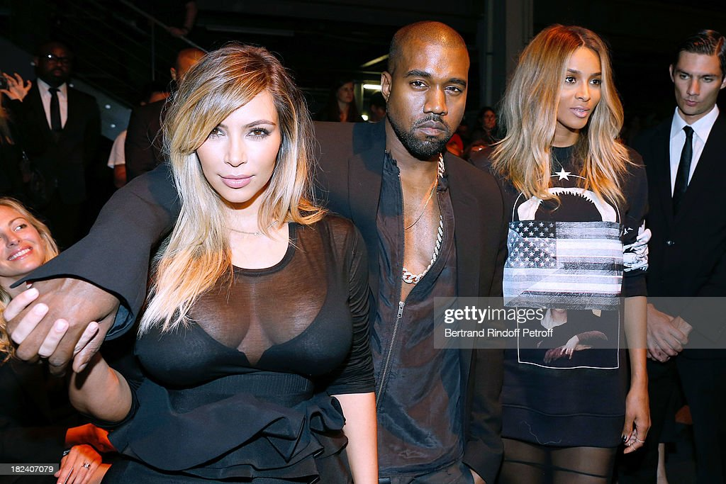 <a gi-track='captionPersonalityLinkClicked' href=/galleries/search?phrase=Kim+Kardashian&family=editorial&specificpeople=753387 ng-click='$event.stopPropagation()'>Kim Kardashian</a>, <a gi-track='captionPersonalityLinkClicked' href=/galleries/search?phrase=Kanye+West+-+Musician&family=editorial&specificpeople=201803 ng-click='$event.stopPropagation()'>Kanye West</a> and singer Ciara attend Givenchy show as part of the Paris Fashion Week Womenswear Spring/Summer 2014, held at 'la Halle Freyssinet' on September 29, 2013 in Paris, France.