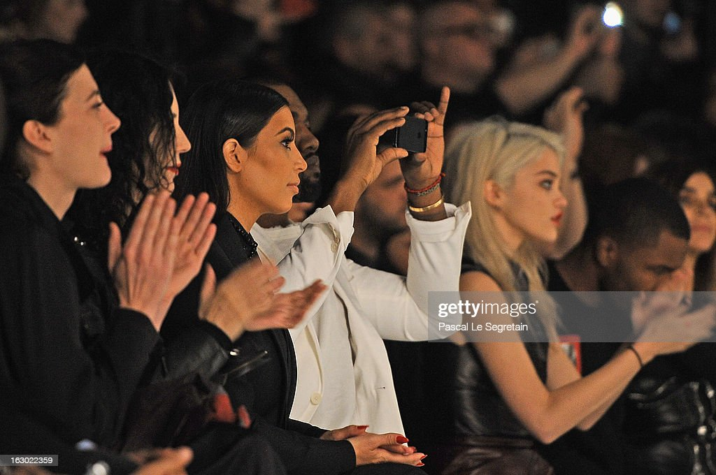 Kim Kardashian (3rd L), Kanye West (4th L) and Sky Ferreira (R) attend the Givenchy Fall/Winter 2013 Ready-to-Wear show as part of Paris Fashion Week on March 3, 2013 in Paris, France.