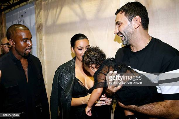 Kim Kardashian Kanye West their daughter North West and Fashion designer Riccardo Tisci pose backstage after the Givenchy show as part of the Paris...