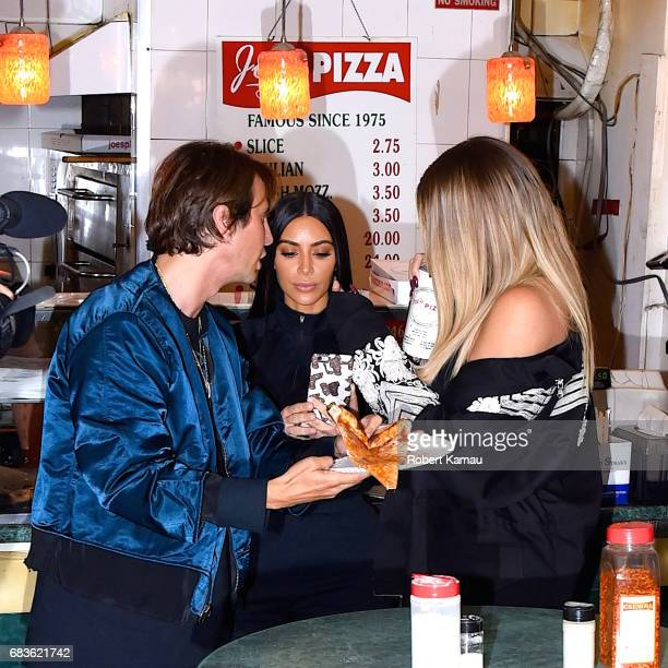 Kim Kardashian Khloe Kardashian and Jonathan Cheban seen out in Manhattan for NY Pizza on May 15 2017 in New York City