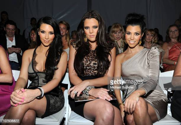 Kim Kardashian Khloe Kardashian and Kourtney Kardashian attend the Beach Bunny Swimwear 2011 fashion show during MercedesBenz Fashion Week Swim at...