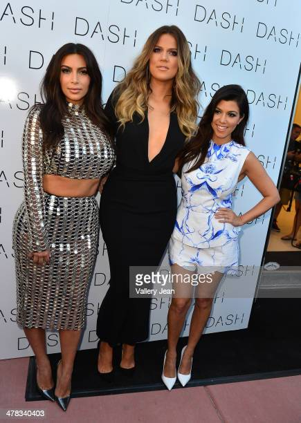 Kim Kardashian Khloe Kardashian and Kourtney Kardashian attend the Grand Opening of DASH Miami Beach at Dash Miami Beach on March 12 2014 in Miami...