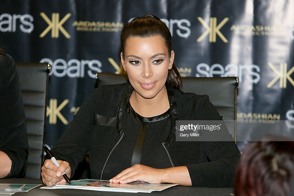 <a gi-track='captionPersonalityLinkClicked' href=/galleries/search?phrase=Kim+Kardashian&family=editorial&specificpeople=753387 ng-click='$event.stopPropagation()'>Kim Kardashian</a> meets with fans and signs autographs at Sears to promote the 'Spring 2013 Kardashian Kollection' on May 4, 2013 in Houston, Texas.