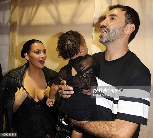 Kim Kardashian North West and designer Ricardo Tisci attend the Givenchy show as part of the Paris Fashion Week Womenswear Spring/Summer 2015 on...