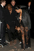 Kim Kardashian North west and Kanye West arrive at the 'Art District' apartments on September 28 2014 in Paris France