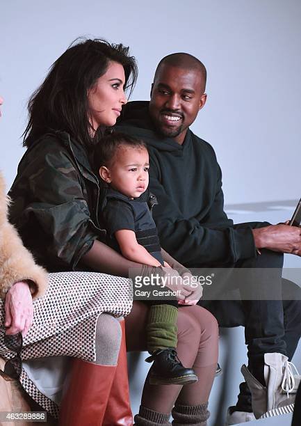 Kim Kardashian North West and Kanye West attend the adidas show during MercedesBenz Fashion Week Fall 2015 at Skylight Clarkson SQ on February 12...