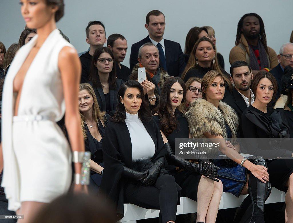 Kim Kardashian, Paz Vega, Yasmin Le Bon and Sophia Assaidi watch a model walk the catwalk during the Stephane Rolland Spring/Summer 2013 Haute-Couture show as part of Paris Fashion Week at Palais De Tokyo on January 22, 2013 in Paris France.