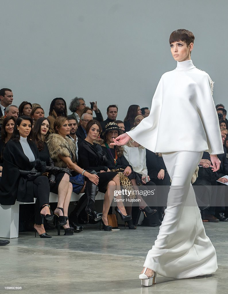 Kim Kardashian, Paz Vega, Yasmin Le Bon and Sophia Assaidi watch Hanaa Ben Abdesslem walk the catwalk during the Stephane Rolland Spring/Summer 2013 Haute-Couture show as part of Paris Fashion Week at Palais De Tokyo on January 22, 2013 in Paris France.