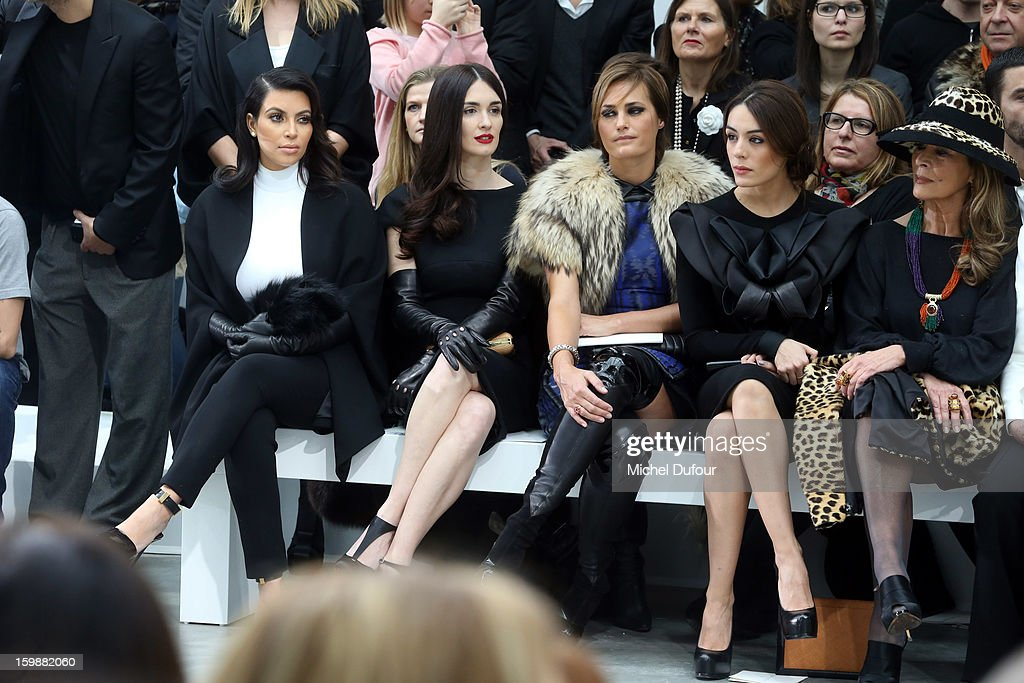 <a gi-track='captionPersonalityLinkClicked' href=/galleries/search?phrase=Kim+Kardashian&family=editorial&specificpeople=753387 ng-click='$event.stopPropagation()'>Kim Kardashian</a>, <a gi-track='captionPersonalityLinkClicked' href=/galleries/search?phrase=Paz+Vega&family=editorial&specificpeople=208840 ng-click='$event.stopPropagation()'>Paz Vega</a>, Yasmine LeBon and Sophia Assaidi sit in front row at the Stephane Rolland Spring/Summer 2013 Haute-Couture show as part of Paris Fashion Week at Palais De Tokyo on January 22, 2013 in Paris, France.