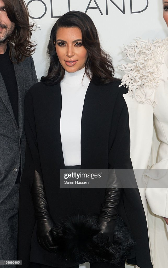 <a gi-track='captionPersonalityLinkClicked' href=/galleries/search?phrase=Kim+Kardashian&family=editorial&specificpeople=753387 ng-click='$event.stopPropagation()'>Kim Kardashian</a> poses backstage at the Stephane Rolland Spring/Summer 2013 Haute-Couture show as part of Paris Fashion Week at Palais De Tokyo on January 22, 2013 in Paris France.
