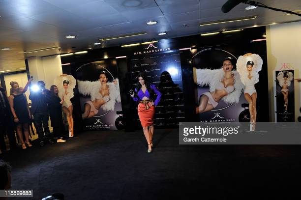 Kim Kardashian poses during her fragrance launch at Debenhams on June 8 2011 in London England
