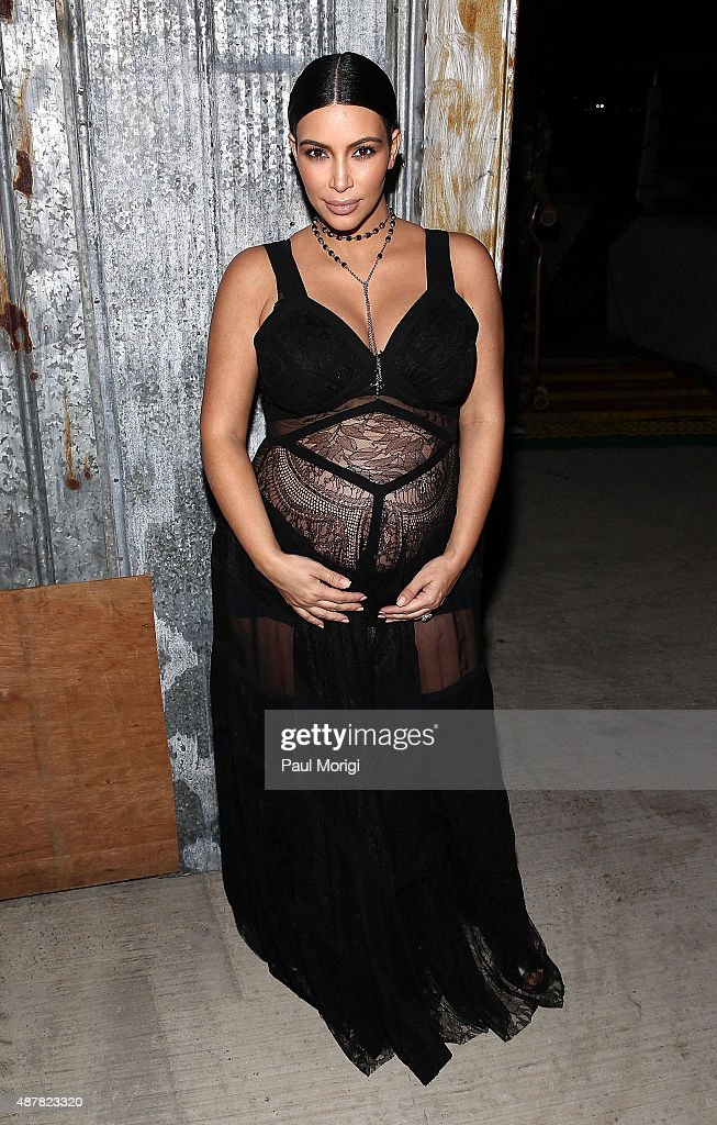 Kim Kardashian poses for a photo at the Givenchy fashion show during Spring 2016 New York Fashion Week on September 11 2015 in New York City