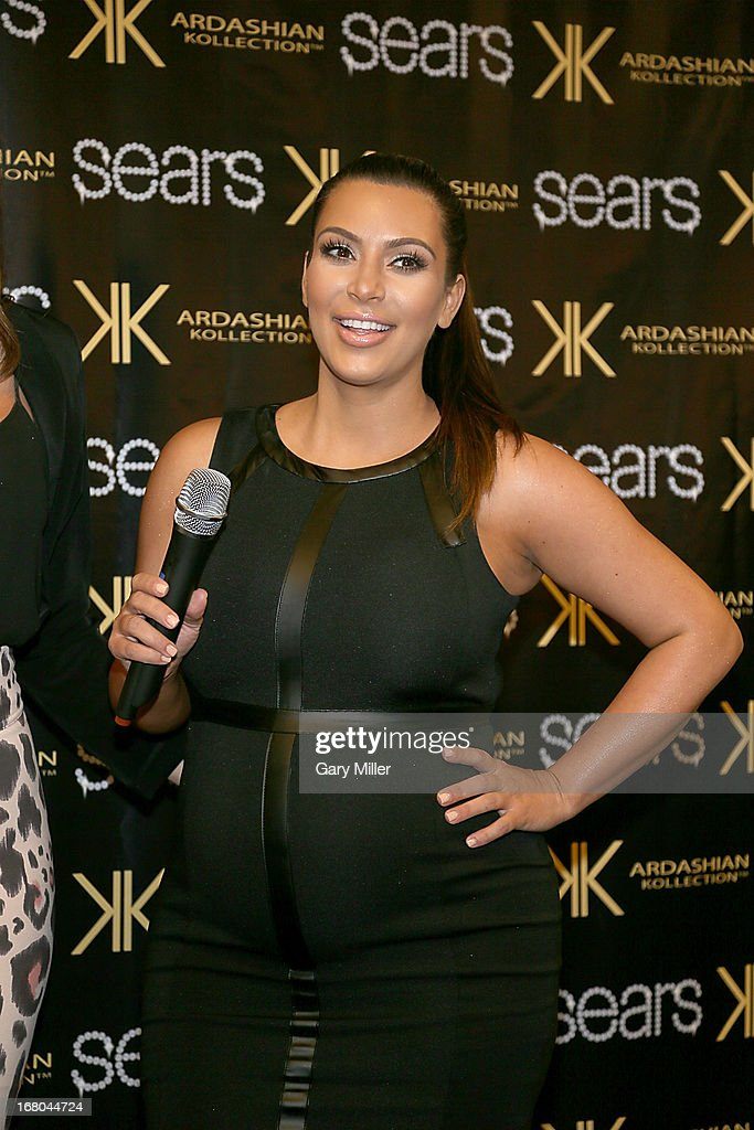 <a gi-track='captionPersonalityLinkClicked' href=/galleries/search?phrase=Kim+Kardashian&family=editorial&specificpeople=753387 ng-click='$event.stopPropagation()'>Kim Kardashian</a> poses on the red carpet at Sears to promote the 'Spring 2013 Kardashian Kollection' on May 4, 2013 in Houston, Texas.