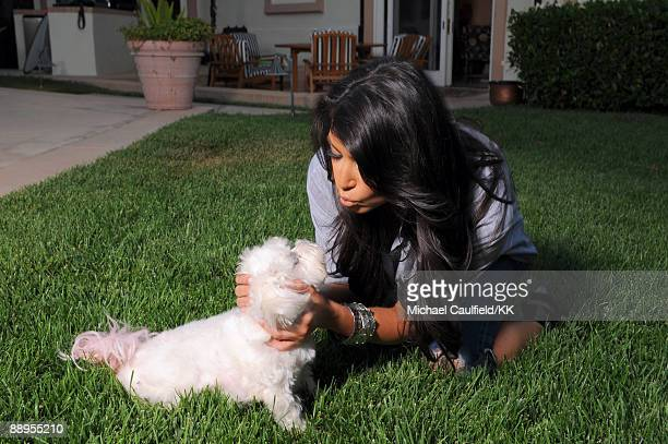 ACCESS*** Kim Kardashian poses with dog Bella during a photo shoot on July 7 2009 in Los Angeles California