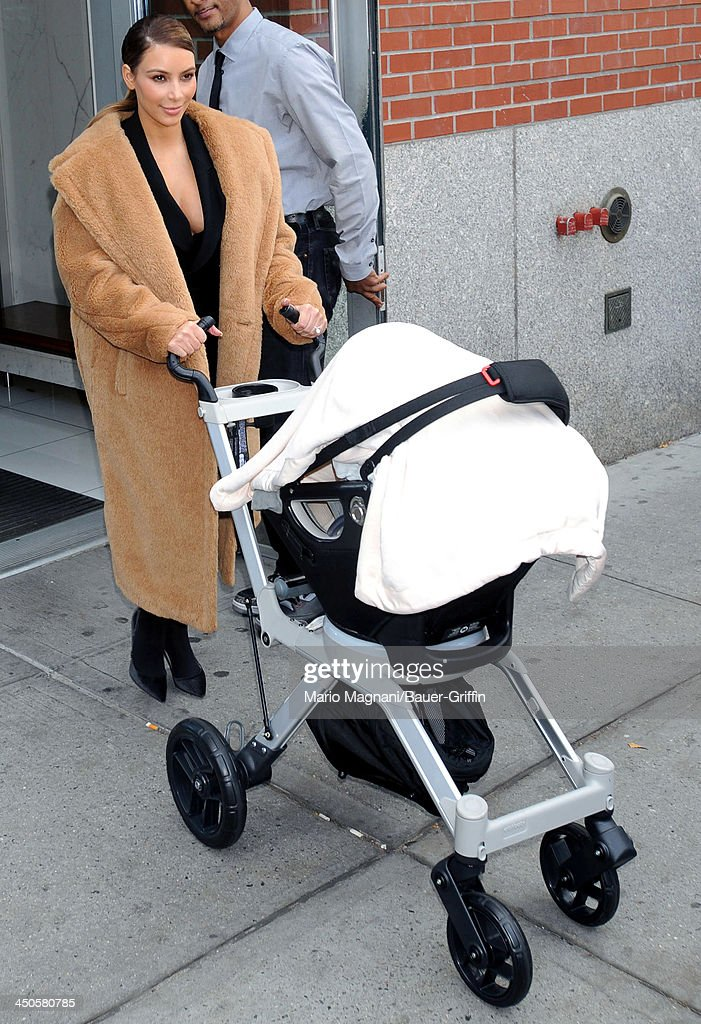 <a gi-track='captionPersonalityLinkClicked' href=/galleries/search?phrase=Kim+Kardashian&family=editorial&specificpeople=753387 ng-click='$event.stopPropagation()'>Kim Kardashian</a> pushes her baby North West in a stroller on November 19, 2013 in New York City.