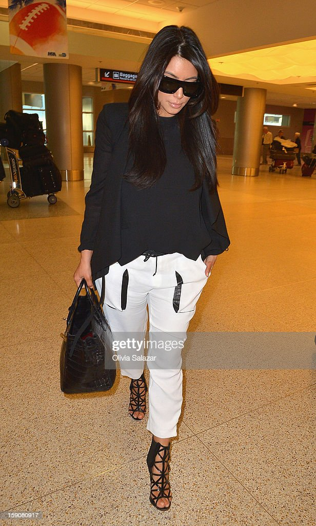 <a gi-track='captionPersonalityLinkClicked' href=/galleries/search?phrase=Kim+Kardashian&family=editorial&specificpeople=753387 ng-click='$event.stopPropagation()'>Kim Kardashian</a> sighting at Miami Airport on January 7, 2013 in Miami, Florida.